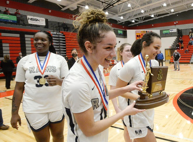Rochester's Alysha Martin, Corynne Hauser and Alexis Robison carry the WPIAL Class 1A championship trophy over to the fans after defeating West Greene 71-41. Hauser and Robison are the Times' 2021 Girls Basketball Players of the Year.