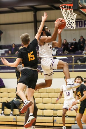 Butler's Donyae MacCaskill (15) goes by Cloud County's Travis Beetch (15) in the first half of Monday night's comeback overtime win.