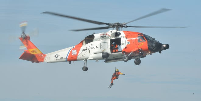 A Coast Guard MH-60 Jayhawk helicopter from Air Station Cape Cod, seen here during a March training exercise, evacuated an injured man from a Point Judith-based commercial boat Sunday.
