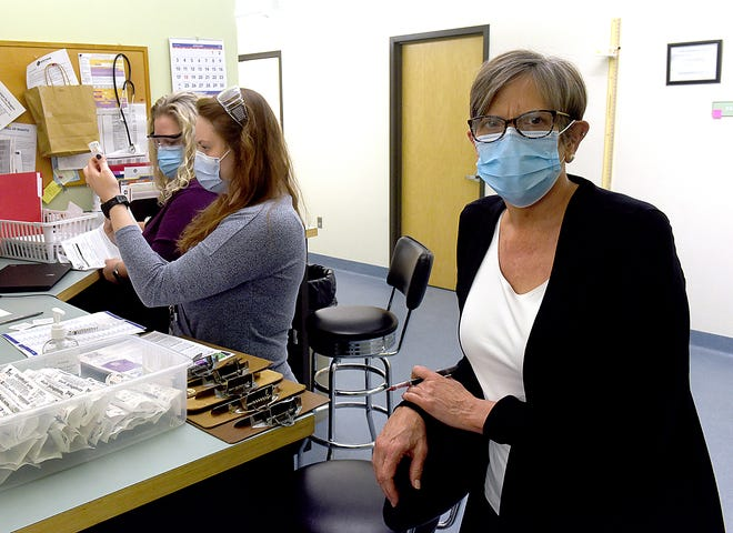 Stephanie Browning, director of Columbia/Boone County Public Health and Human Services, poses for a photo Tuesday while nurses Trina Teacutter, far left, and Taylor Sutter, center, prepare a shot for a patient. Browning and her team have been fighting COVID-19 since before it appeared in mid-Missouri.