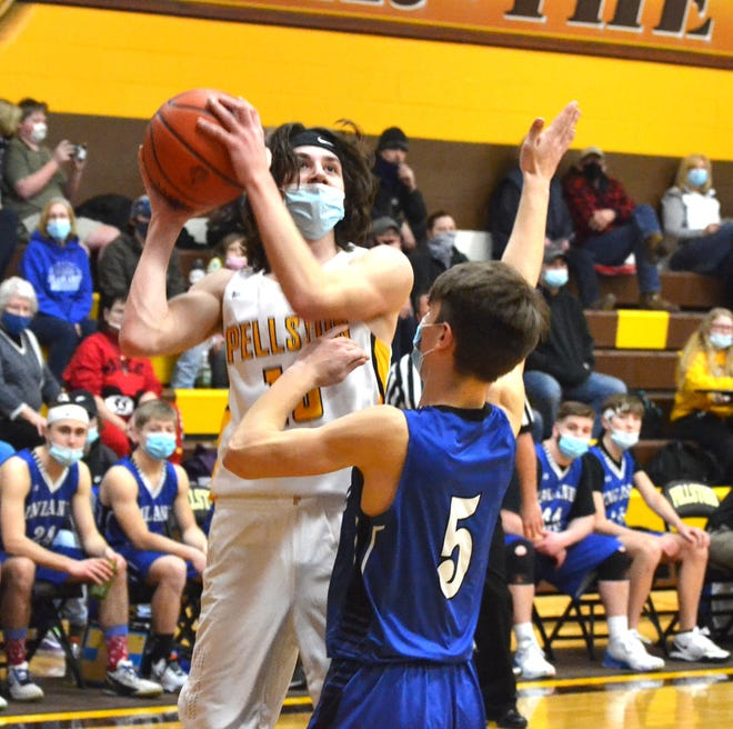 Senior center Chase Zink's (left) 14 points helped the Pellston boys basketball team earn a win at Pickford on Monday night.