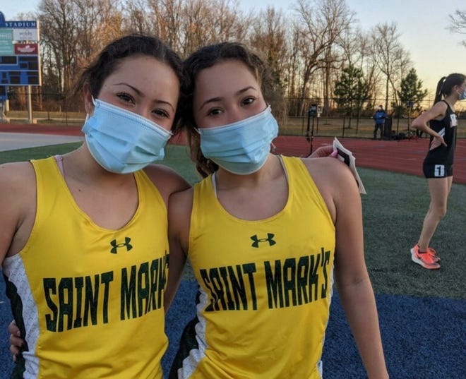 Identical twins Tiffany and Stephanie Herrera took first and second place for Saint Mark's High School in the 3,200-meter event at the Girls Indoor Track State Championship.