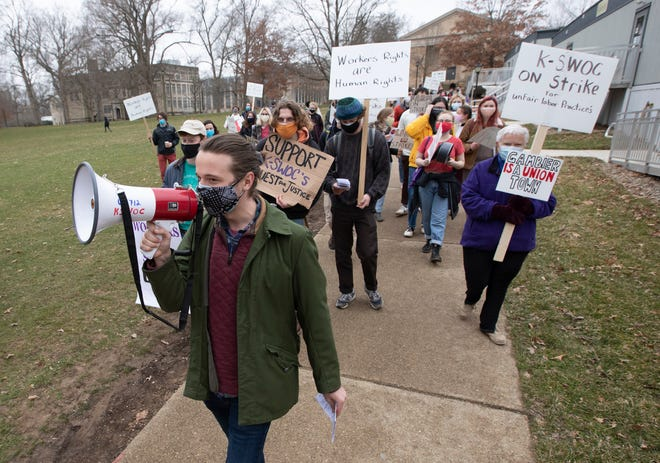 While chanting and carrying picket signs, senior Graham Ball, 22, of Cleveland, leads student workers at Kenyon College in a march across campus Tuesday.