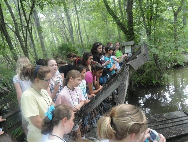 Children learn about the local ecosystem at the South Louisiana Wetlands Discovery Center's annual Swamp Camp in 2019.