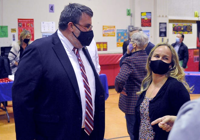 Eric Jurkovic, the new West Holmes superintendent, talks with Ashley Ogi after the board meeting held at Nashville Elementary.