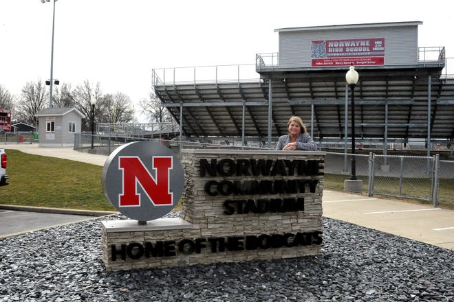 Retiring Norwayne Local Superintendent Karen O'Hare stands in front of the school district's stadium, which went through a large renovation project that included adding artificial turf, under her tenure.