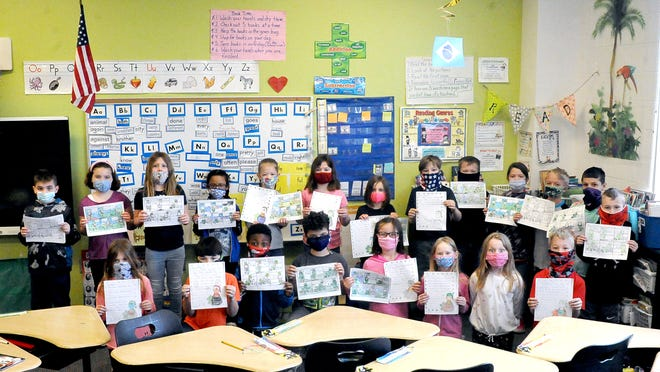 Michelle Sundberg's second grade class at Green Elementary Schools are shown with letters they wrote to residents at Doylestown Health Care Center. Sundberg gave students a blank comic strip with a leprechaun theme, and they wrote a story to go along with the pictures... and colored them.