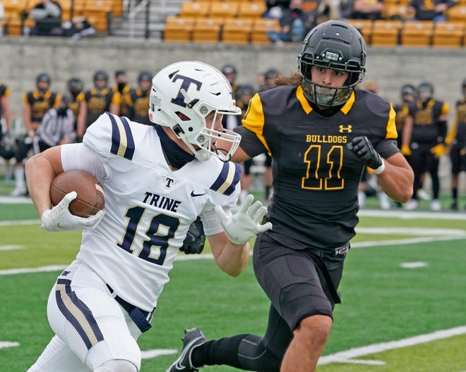 Adrian College linebacker Sam Madrid (Adrian High School graduate) chases down Trine wide receiver Brandon Kline during game in the fall of 2020.