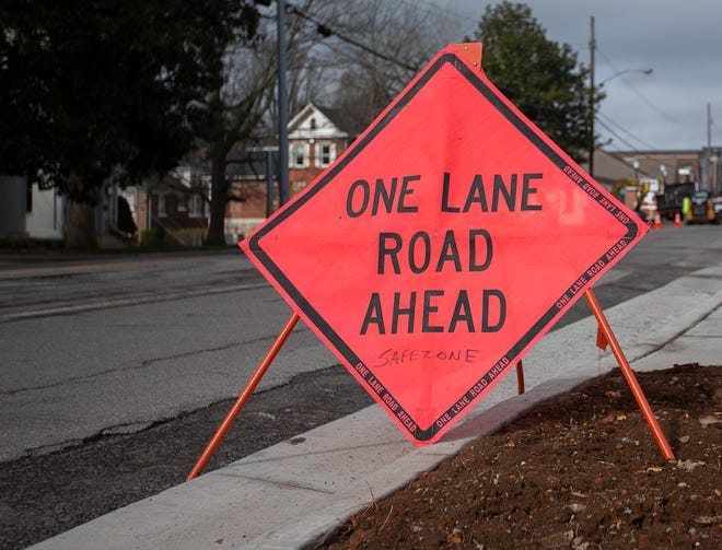 Work on the road improvement and sidewalk expansion project along West 7th Street continues in Columbia, Tenn., on Tuesday, March 16, 2021.