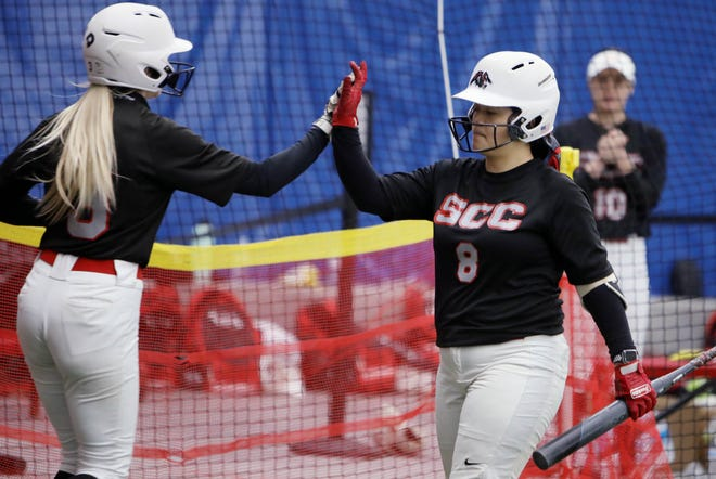 Southeastern Community College's Kassie Reid (3) is congratulated by Arianna Ramirez (8) after scoring during the first game of a double header against Illinois Central College, Tuesday March 16, 2021 at the Fun City Turf.