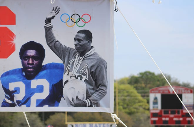 A banner pictures former Olympic sprint champion and Hall of Fame wide receiver Bob Hayes at Raines High School. The Bob Hayes Invitational Track Meet returns Saturday after its 2020 cancellation due to COVID-19.