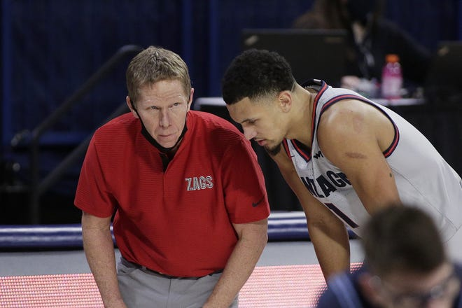With guard Jalen Suggs (R) leading the way, Gonzaga coach Mark Few (L) and the Bulldogs have the prolific offense needed to finally win it all.