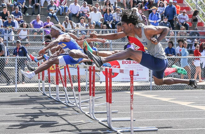 Sandalwood's Edwin Carter (far right) and other athletes clear the 110-meter hurdles at the 2018 Bob Hayes Invitational. After a one-year hiatus due to COVID-19, the track meet returns Saturday to Raines.