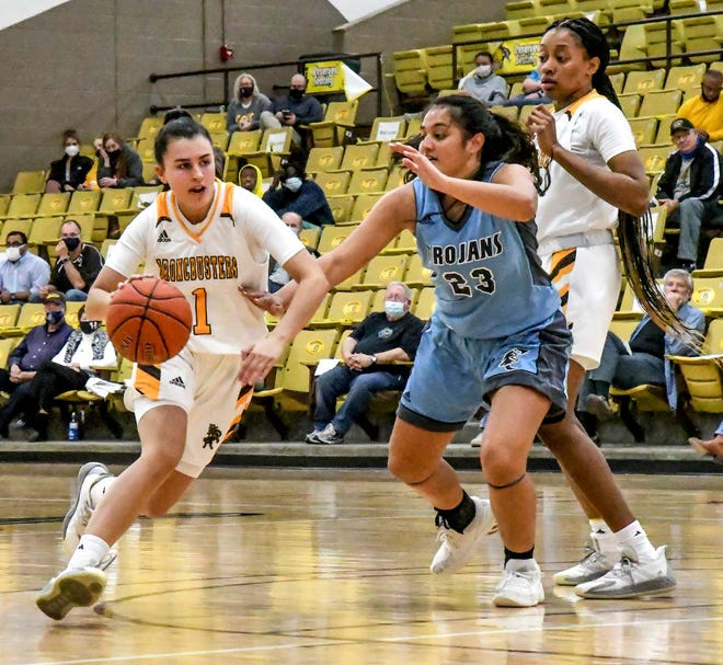 Garden City Community College's Elisabeth Matas-Martin, left, drives in to the lane for a basket past Colby's Marveen Ross March 10 at Perryman Athletic Complex.