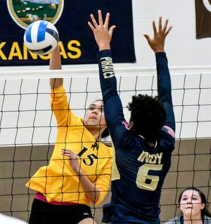 Garden City Community College's Pulelehua Keb, left, makes a kill past Independence's Bianca Brierre March 11 during a match at Perryman Athletic Complex.