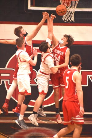 Orion's Chance Stropes, center, battles a pair of Morrison players for a rebound on Friday, March 12, when the Chargers closed out the 2021 season. Behind Stropes on left is Will Dunlap.