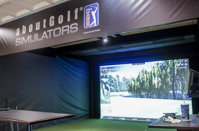 A golf simulator Iron Spike Players' Lounge.