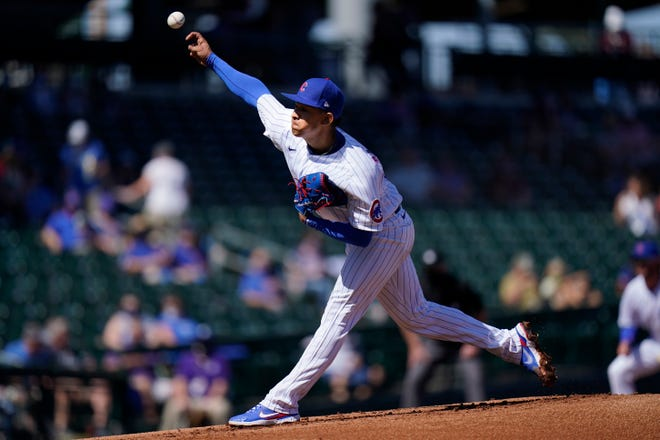 Chicago Cubs starting pitcher Adbert Alzolay throws against the Kansas City Royals during the first inning of a spring training game in Mesa, Ariz. on Tuesday, March 2.