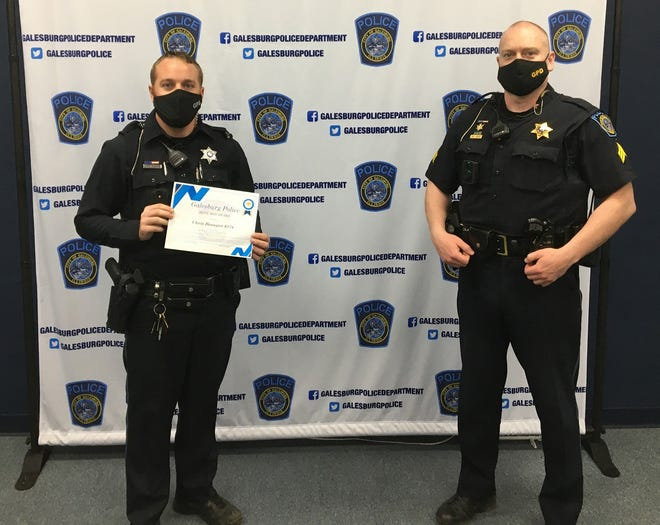 Galesburg Police officer Chris Beaupre was recently presented with a Blue Max award. Also pictured is Sgt. Patrick Kisler.