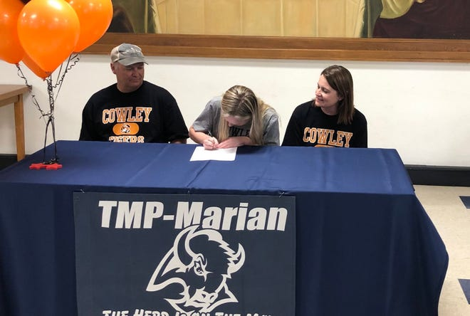 TMP-Marian's Abby Rueschhoff signs her letter of intent with Cowley Community College for track and field this past Thursday at the TMP cafeteria.