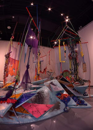 Two fiber-textile themed art installations are on display at the Spartanburg Art Museum, at the Chapman Cultural Center in Spartanburg, Tuesday, March 16, 2021. One of the large fiber-based installations created by artist Liz Miller.
