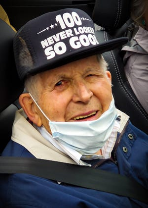 Albert Sharke looks on during his 100th birthday parade.
