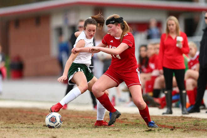 Hendersonville Bearcats Aubrey Bish (14) fights for the ball against East Henderson's Drake Waggoner in a match during the 2019 season.