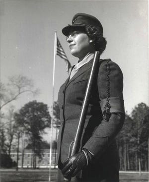 A female Marine takes her turn on sentry duty at Marine Corps Women's Reserve Schools at Camp Lejeune in 1943.