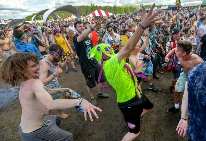 Greg Salyers, aka SQUDM4N, of Louisville, Ky. and his crew boogie down to the electronic dance beats of Slumberjack during the Summer Camp Music Festival on Sunday, May 26, 2019 at Three Sisters Park in Chillicothe. This year's event has been moved to August, with most acts accommodating the switch.