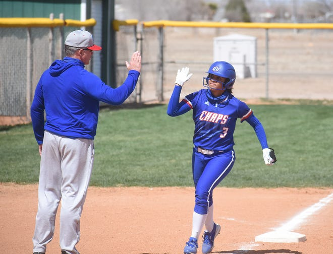LCU coach Daren Hays congratulates freshman Kamryn Gibbs on her second-inning homer, part of a back-to-back with Alivia Villareal, in the first game of Monday's Lone Star Conference doubleheader at Eastern New Mexico. LCU swept the two games 10-0 and 14-3.