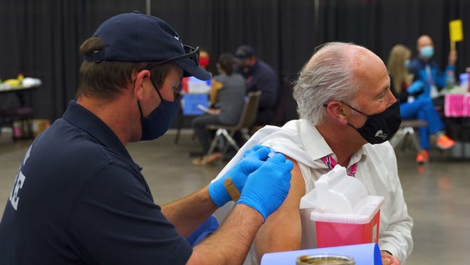 Mayor Dan Pope receiving his first COVID vaccine at the Lubbock Memorial Civic Center on Tuesday, March 16, 2021.