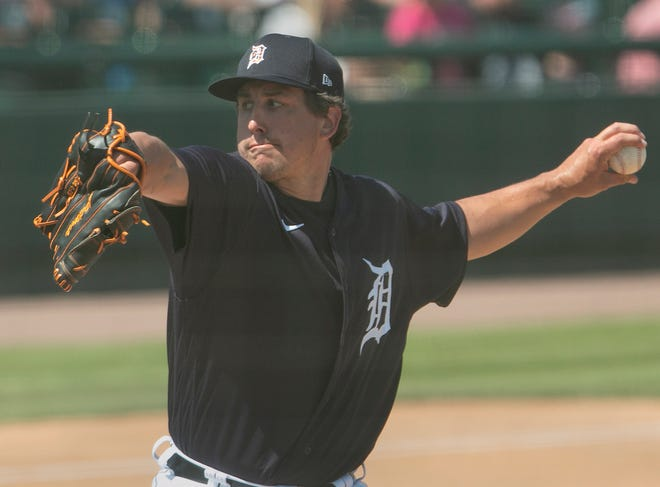 Detroit Tigers pitcher Derek Holland winds up during the fourth inning against the New York Yankees at Publix Field at Joker Marchant Stadium.