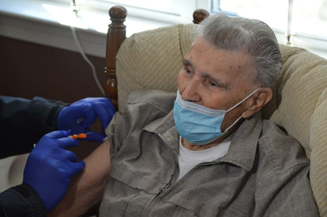 Raymond Mahan is vaccinated at his Leominster home as part of the Last Mile Vaccine Delivery clinic Tuesday, March 16.