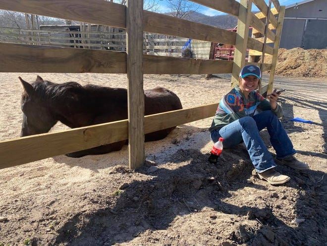"""How are things going between Addi Cross and her new mustang Mick?As Addi was being interviewed by phone for this article, she sat down just outside of the pen to talk. Mick got up, went to the edge of the pen where Addi was, and laid down beside her.""""He loves her,"""" Addi's mom Lori Troutman stated."""
