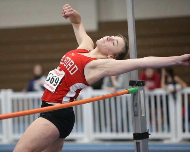 Milford's Sarah Brogioli competes int he high jump during the Hockomock League indoor track meet at the Reggie Lewis Center in Boston on Jan. 16, 2020. On Monday, Brogioli helped her volleyball team beat Attleboro.