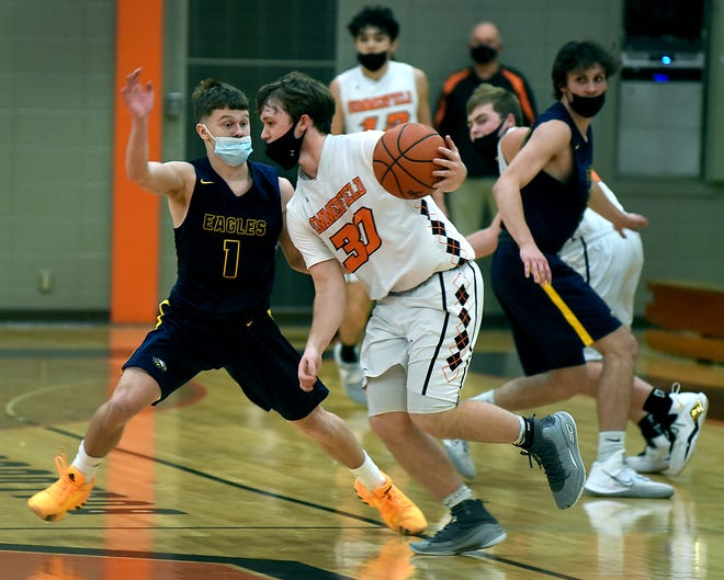 Zach Brown of Mason applies the pressure onto Brock Olmstead of Summerfield in the first half Monday night.