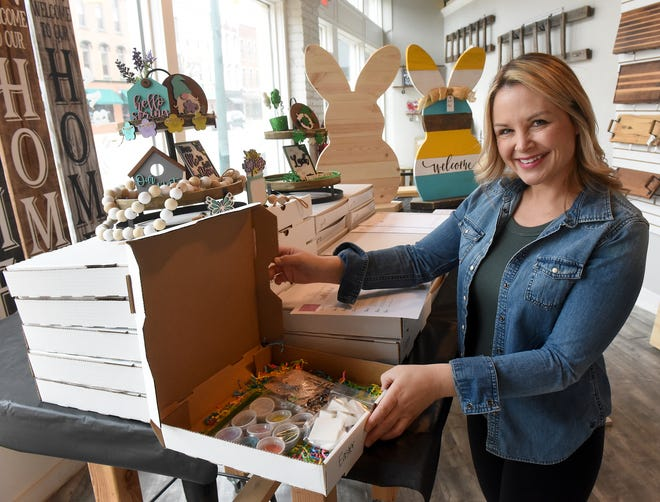 Andrea Lechner, owner of Barn Owl Studio in Monroe, shows one of her do-it-yourself Easter decoration kits, which can be purchased online or in-store. Lechner and other local business owners had to adapt quickly to survive when the COVID-19 pandemic hit last March.