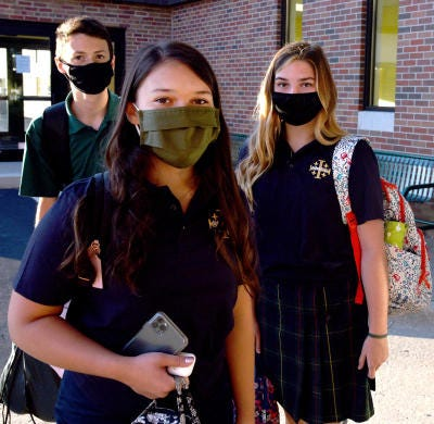 Sisters Sophia and Gracie Gentry, along with freshman Simon Vanderviuch, were the first students to enter St. Mary Catholic Central High School on the first day of classes in August.