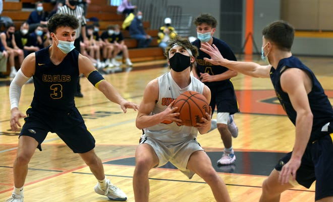 Brandon Thompson of Summerfield looks to go to the hoop guarded by Tanner Herrera and Zach Brown Monday, March 15, 2021.