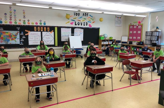 Students in Ms. Giroux's first grade class were masked and ready to learn on March 15.