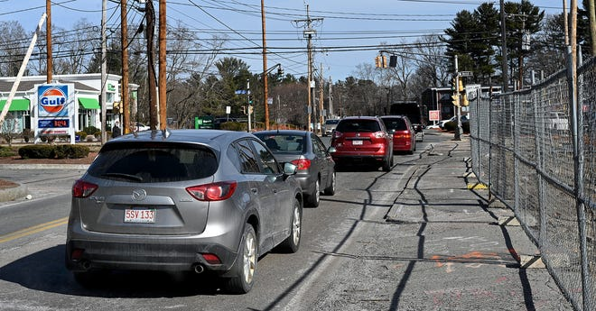 Traffic collects at the intersection of Edgell Road, Edmands Road  and Water Street in Framingham, March 16, 2021.