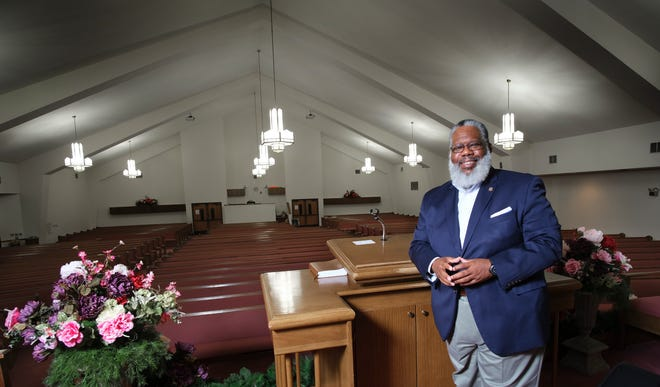 Rev. Ray Douglas, senior pastor of Mount Olive Baptist Church, in the sanctuary on Tuesday.