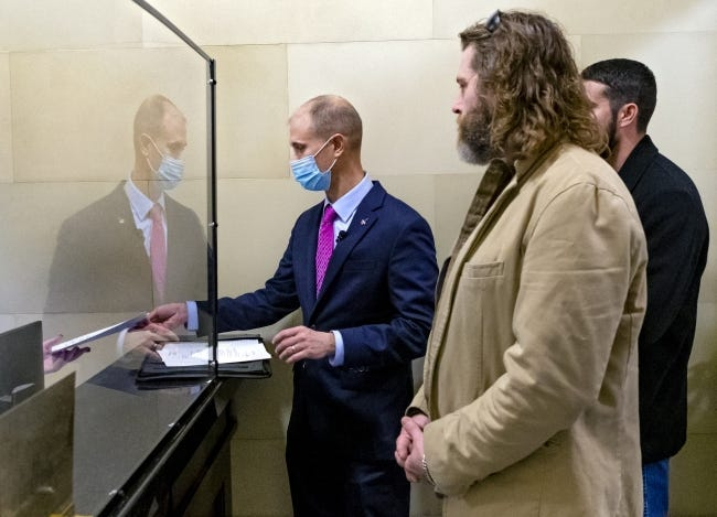 Attorney Frank Urbanic files a letter at the state Capitol in early December protesting curfews for bars and restaurants.