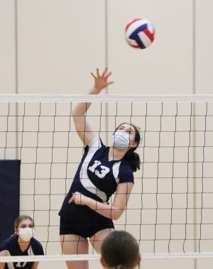 Sophia Karr of St. Mary's delivers an attack in the Saints' eighth grade volleyball regional final against Grand Ridge Monday. SMS won the match and regional title 25-6, 25-11.