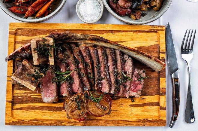 "Avalon's heftiest steak: a 36-ounce, 30-day aged prime ""tomahawk"" bone-in rib-eye. HOST RESTAURANTS"