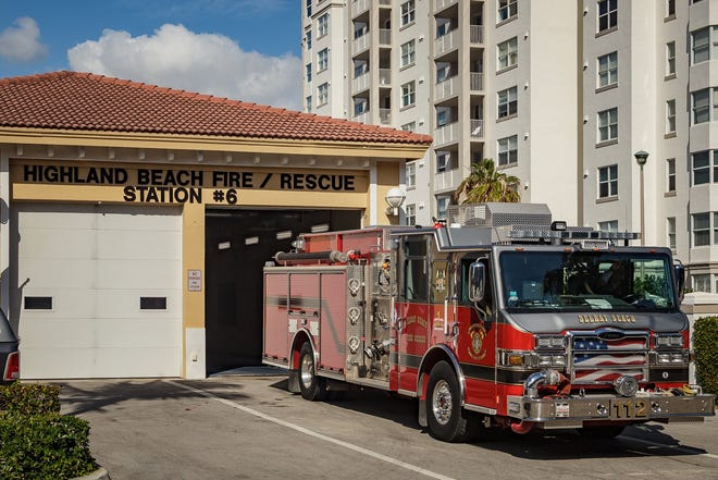 A Delray Beach Fire Rescue truck pulls away from the Highland Beach Fire Rescue Station No. 6 in Highland Beach, Fla.