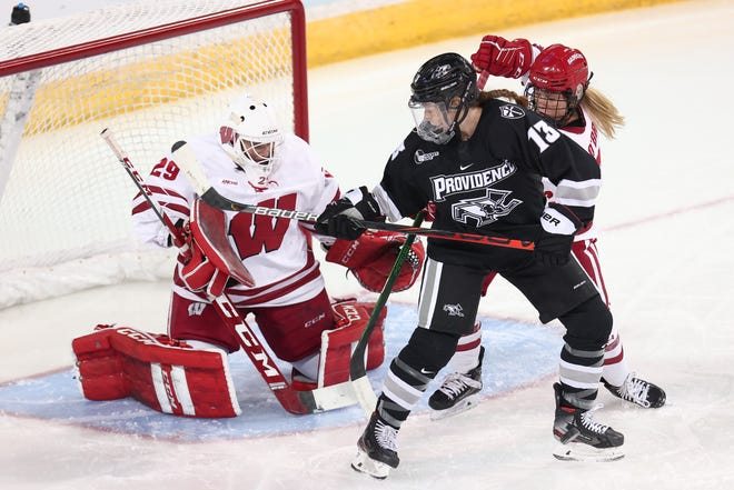 Providence College's Delaney Couture (13) puts a shot on goal against Wisconsin netminder Kennedy Blair in Tuesday's quarterfinal matchup in the NCAA Tournament at Erie, Pa. Wisconsin won, 3-0.