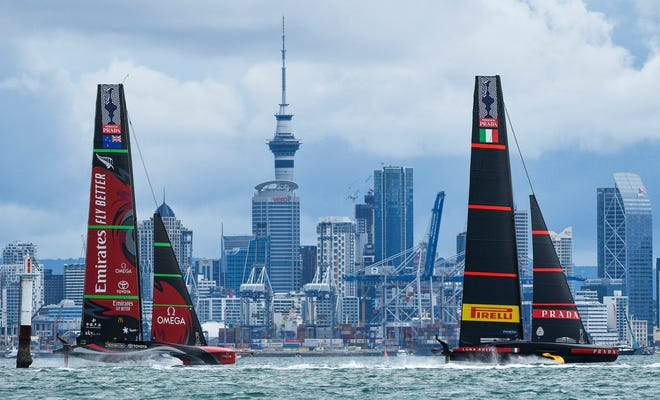 Italy's Luna Rossa, right, races Emirates Team New Zealand in race nine of the America's Cup on Auckland's Waitemata Harbour on Tuesday.