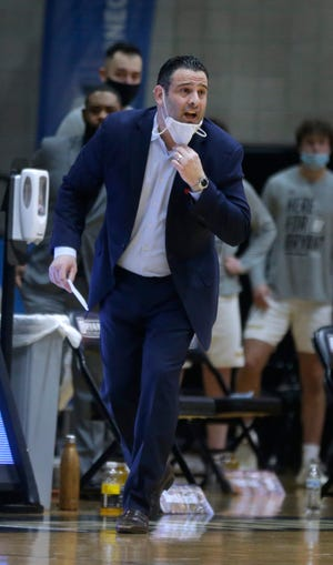 Bryant coach Jarred Grasso has been named the District 1 Coach of the Year by the U.S. Basketball Writers Assoc.