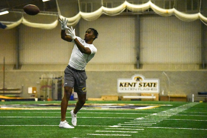 Former Kent State star wide receiver Isaiah McKoy makes a catch during his Pro Day workout on Monday at the KSU Field House.